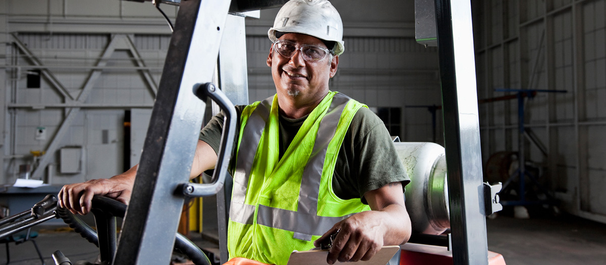 man sitting in forklift
