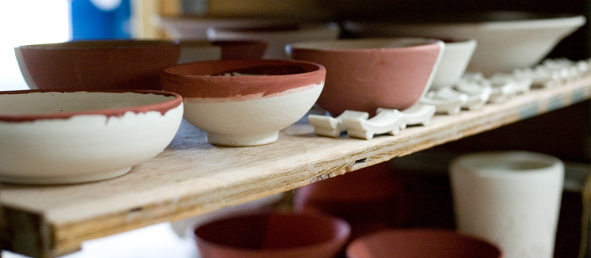 ceramic bowls on shelf