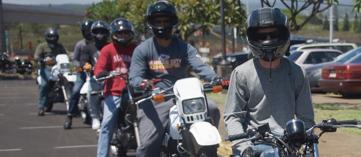 students on motorcycles