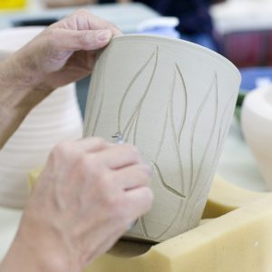 Raku Student Carving Relief.