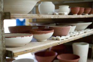 Ceramic Pots And Bowls On Shelf.
