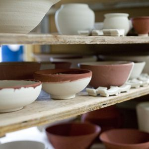 Ceramic Pots And Bowls On Shelf.