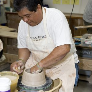 Raku Student At Pottery Wheel.