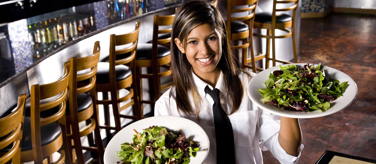 Waitress ready to serve salads.